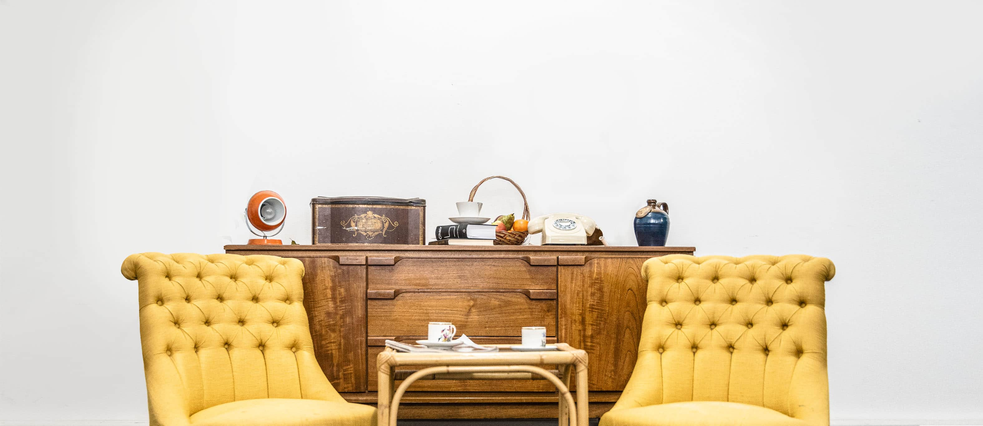 Two yellow chairs and a sideboard